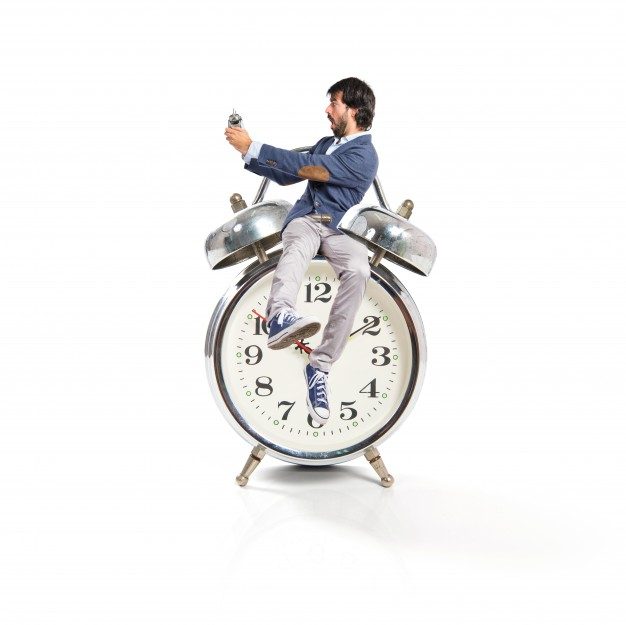 man-holding-a-clock-over-white-background_1368-6152